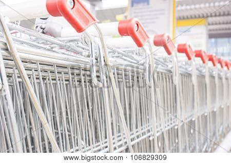 Many Empty Shopping Carts In A Row.