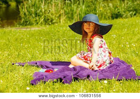 Cute Little Girl In Big Hat Pretending To Be Lady