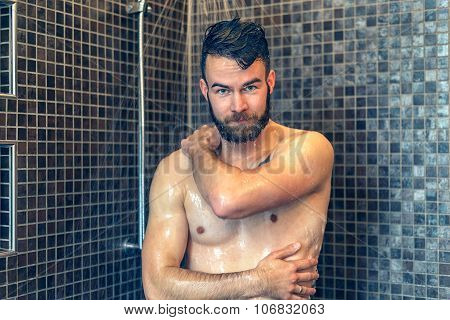 Friendly Young Man Soaping Himself In The Shower