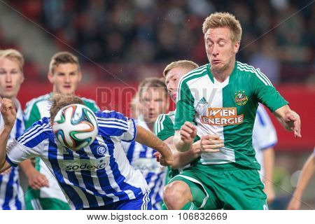 VIENNA, AUSTRIA - AUGUST 28, 2014: Markus Heikkinen (#6 Helsinki) and Robert Beric (#9 Rapid) fight for the ball in an UEFA Europa League qualifying game.