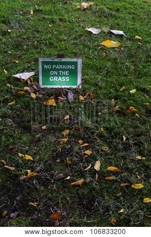 No Parking On The Grass Sign Over Green Lawn