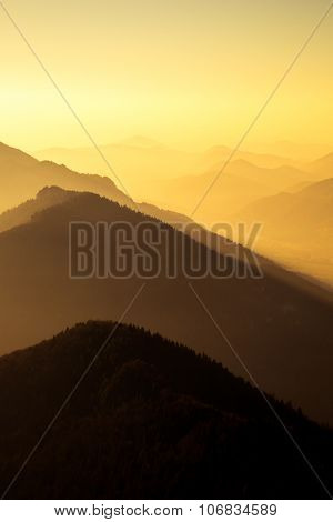 Scenic View Of Mountains And Hills Silhouette At Sunset