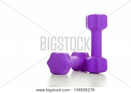 Fitness Concept With Two Purple Dumbbells On White Background