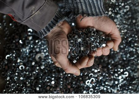 hex nuts in hands