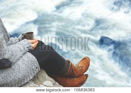 Photography of woman near beautiful waterfall on rocks