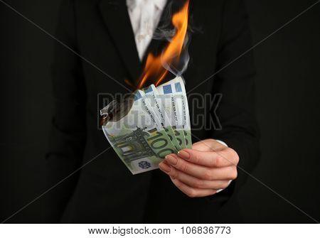 Woman burning  Euros closeup