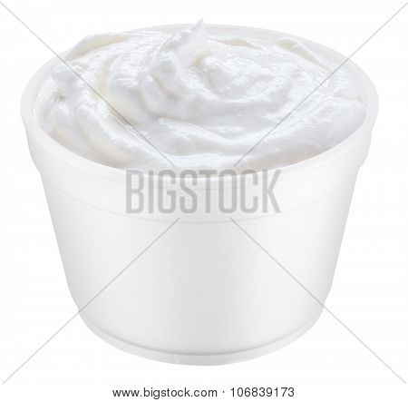 Sour cream in the polystyrene cup. File contains clipping paths.