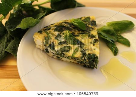 Omelet with spinach and leek with olive oil