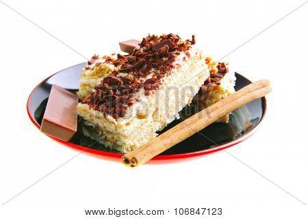 dark chocolate bars and light cake on small saucer