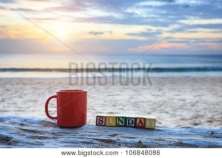 Coffee Cup On Wood Log At Sunset Or Sunrise Beach