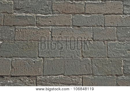 Limestone medieval wall of stone blocks texture background surface empty