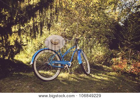 A classic baby blue cruiser standing in the shade