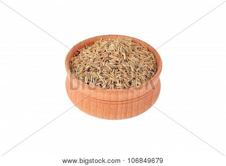 Cumin in wooden bowl