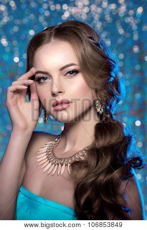 Winter woman model gorgeous beauty makeup stylish hairstyle Young girl background bokeh Lady make up Mascara long lashes lipstick lips eye shadow shiny hair manicure nail polish Products Treatment