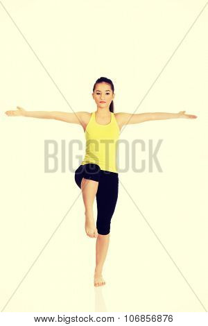 Young fitness woman with arms wide open.