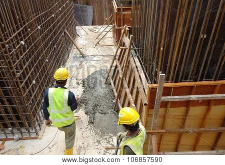 Broken formwork and splash of concrete slurry