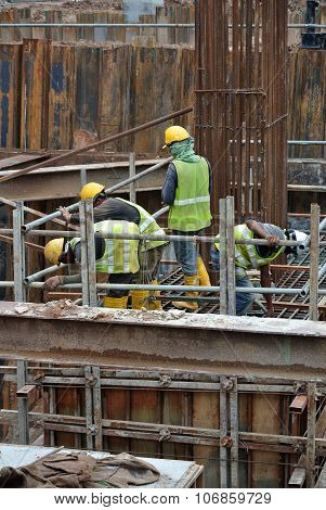 Construction workers preparing pile cap for concreting work