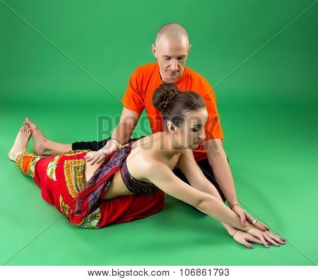 Yoga. Image of coach helps woman to perform asana