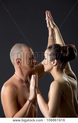 Sexual yoga. Portrait of naked partners training
