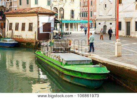 Venice. Garbage barge.