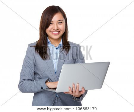 Aisan Young Businesswoman use of the notebook computer