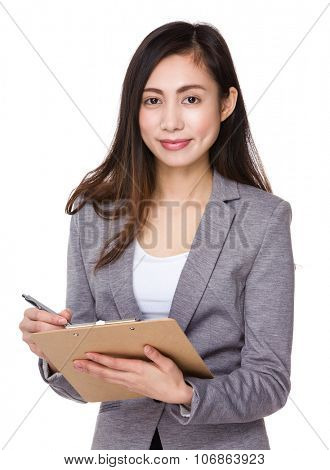 Young Businesswoman write on clipboard