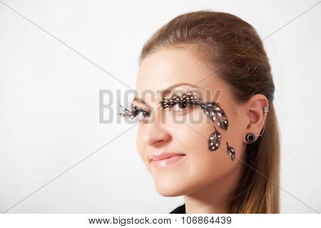 Beautiful Woman With Long Eyelashes And Face-art