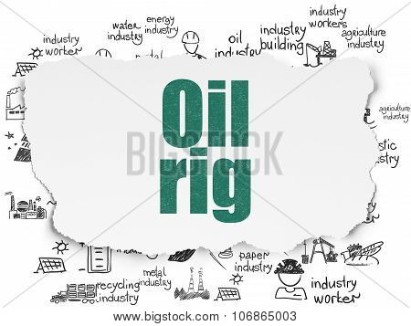 Manufacuring concept: Oil Rig on Torn Paper background