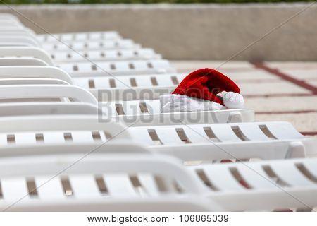 Santa Claus Hat On Sunbed Near Swimming Pool