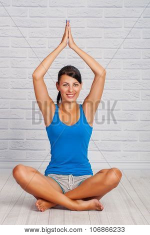young girl is engaged in yoga