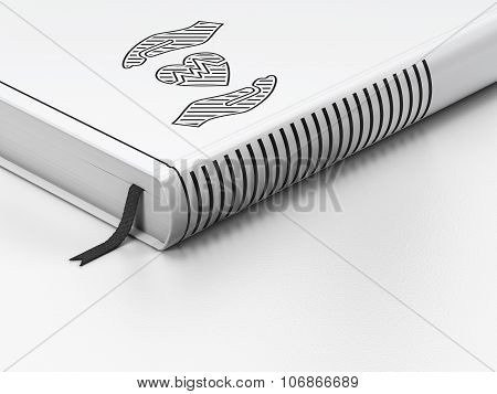 Insurance concept: closed book, Heart And Palm on white background