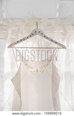 White Dress On Clothes Hanger