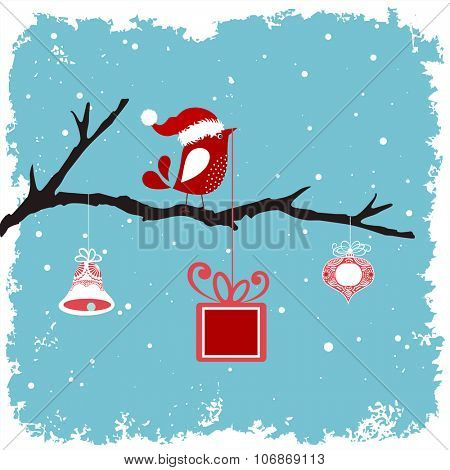 bird in a santa hat on a branch with bell bauble and gift -Winter grunge snowy background