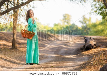 A Girl In A Long Dress Walking On The Road Turned And Looked Into The Frame