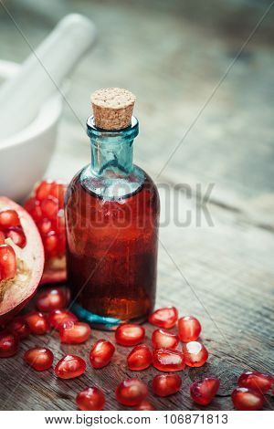 Pomegranate Juice Or Tincture And Garnet Fruit With Seeds On Wooden Rustic Kitchen Table.