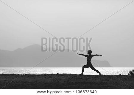 Woman Meditating In Yoga Pose Silhouette