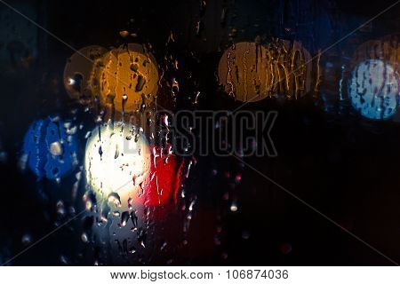 Car Headlights And Streetlights In Rain