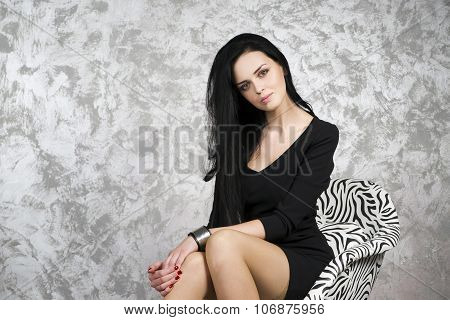 Beautiful Young Woman In A Armchair
