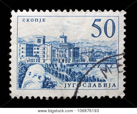 YUGOSLAVIA - CIRCA 1958: Stamp printed in Yugoslavia shows a Bridge at Skopje, with inscription