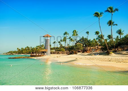 Paradise Tropical Island In Dominican Republic. White Sand, Blue Sea, Clear Sky And  Lighthouse On S