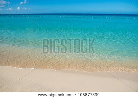 Azure Turquoise Calm Sea, Clear Blue Sky, Sandy Beach And Flat Horizon