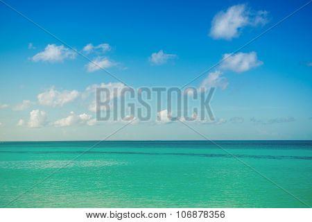 Calm Sea, Ocean And Blue Cloudy Sky. Horizon. Picturesque Seascape