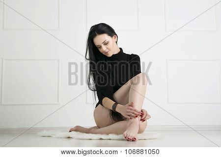 Beautiful Young Woman With Long Legs In Bodysuit