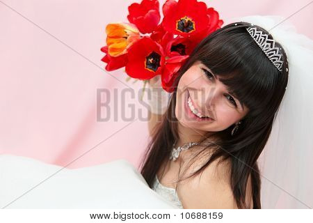 Smiling bride with tulips