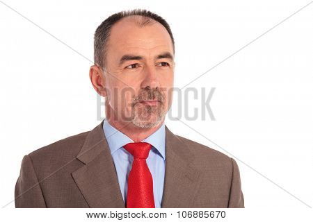 side view of a mature businessman looking away from the camera on white background