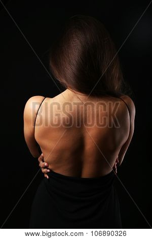 View on woman's back in open dress, close-up