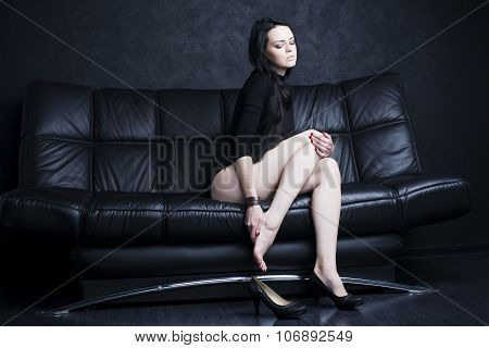Beautiful Young Woman With Long Legs In Bodysuit. Leg Pain