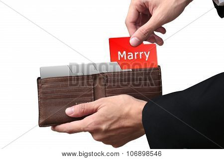 Businessman Hands Pulling Money Marry Concept On Brown Wallet.