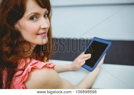 Mature student in lecture hall using tablet at the university