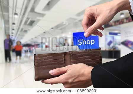 Businessman Hands Pulling Money Shopping Concept On Brown Wallet.